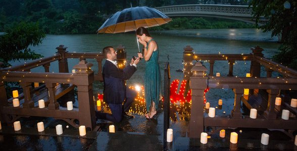 Photo of Taddy proposing in the rain