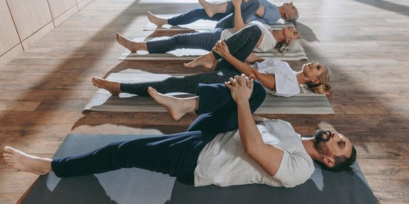 Photo of people in a yoga class