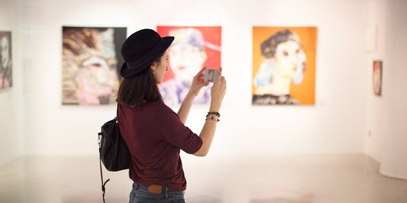 Photo of a woman at an art gallery