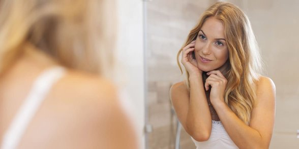 Photo of a woman looking in a mirror