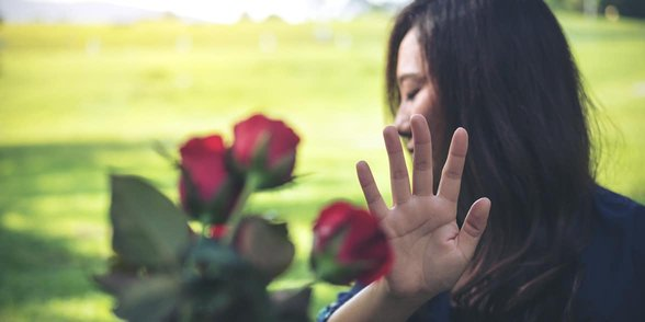 Photo of a woman rejecting flowers