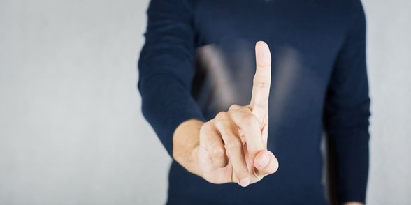 Photo of a man wagging his finger
