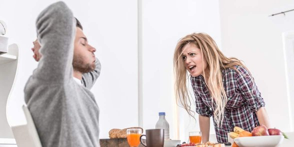 Photo of a woman yelling at a man