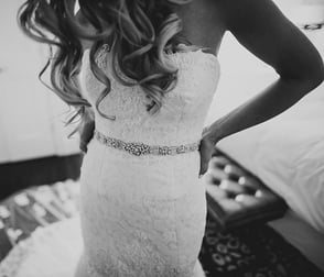 Photo of a bride trying on a wedding dress at Bridal Reflections