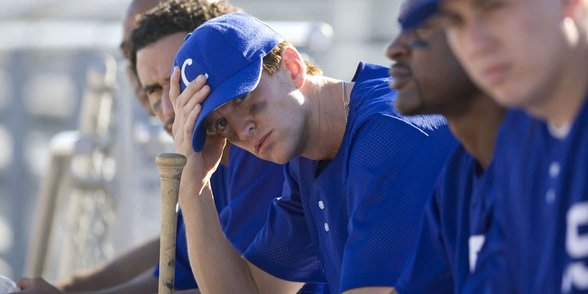 Photos of baseball players on a bench