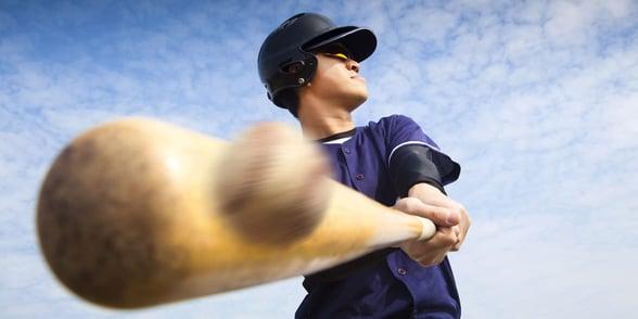 Photo of a baseball player hitting a ball