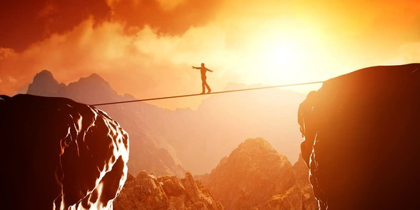Photo of a man on a tightrope