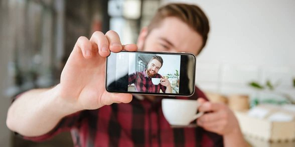 Photo of a man taking a selfie