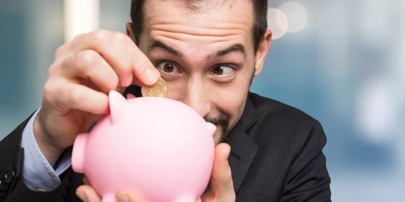 Photo of a man with a piggy bank