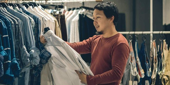 Photo of a man shopping for clothes