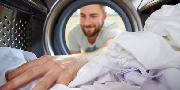 Photo of a man doing laundry