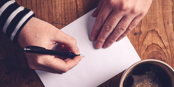 Photo of a person writing a letter