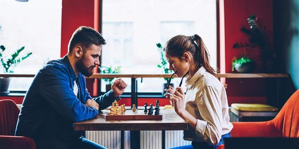 Photo of a couple playing chess