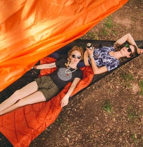 Photo of a couple in a Tentsile giant hammock