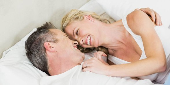 Photo of mature couple in bed