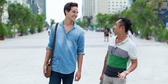 Photo of two gay men talking