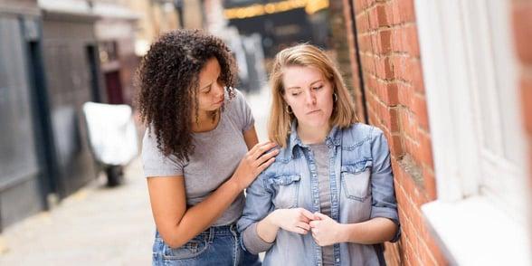 Photo of a sad lesbian couple