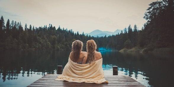 Photo of lesbian couple at a lake