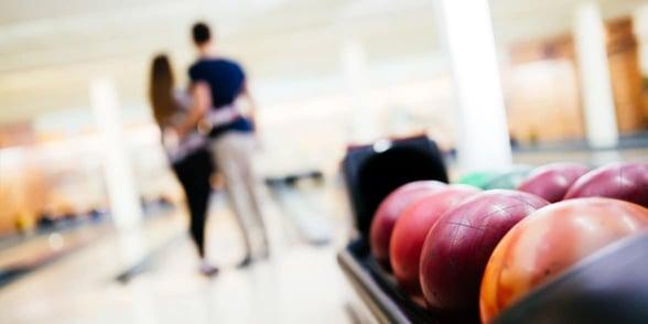 Photo of couple bowling