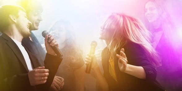 Photo of people doing karaoke