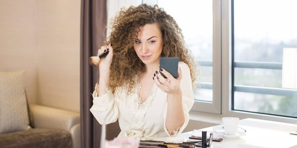 Photo of woman putting on makeup
