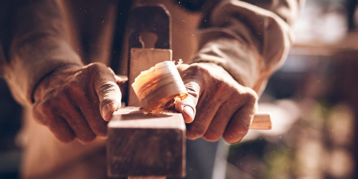 Photo of a man woodworking