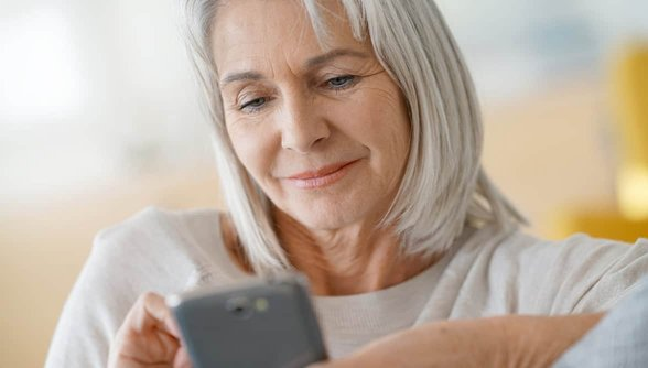 Photo of older woman on smartphone