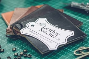 The Leather Satchel co. logo on leather samples