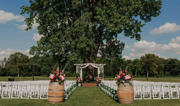 Photo of outdoor daytime wedding setup