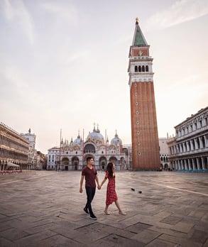 Photo of couple walking through Italian city