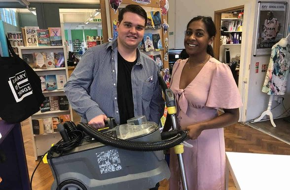 Photo of couple borrowing a carpet cleaner from the Library of Things