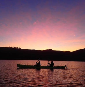 Photo of two people kayaking