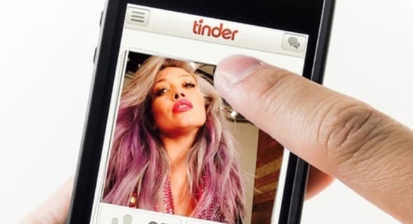 Photo of someone swiping on Tinder