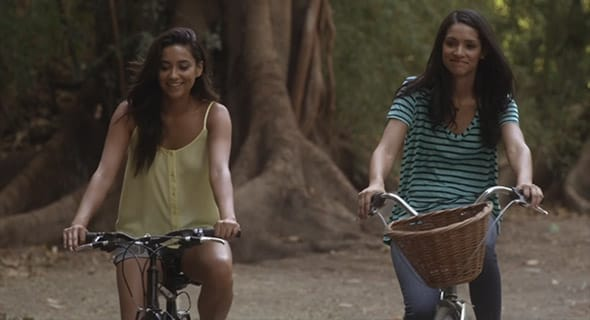 Photo of Emily and Talia from Pretty Little Liars riding bikes