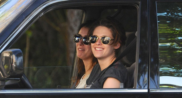 Photo of Kristen Stewart driving an SUV