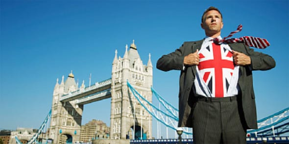 Photo of British man in front of London Bridge