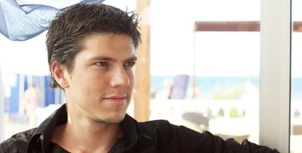 A photo of an attractive man looking off to the side and not smiling