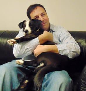 Photo of Darrell Lerner and his dog, Kona