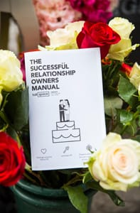 Photo of a Talkspace relationship manual in a wedding bouquet