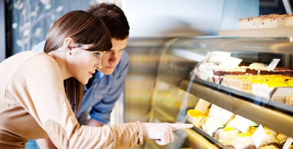Photo of a woman and man looking at sweets