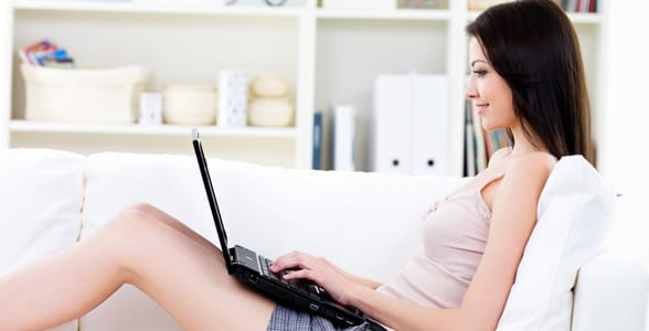 Photo of a girl typing on her laptop