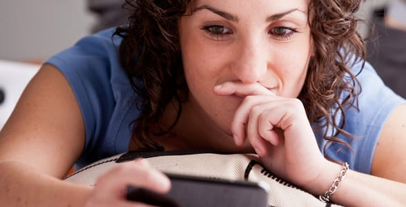 Photo of a girl texting on her phone