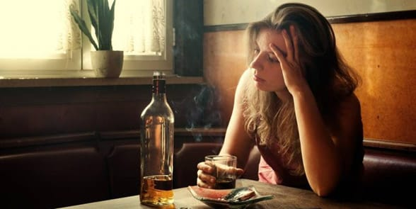 Photo of a woman drinking alone