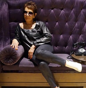 Photo of Dorrie Jacobson posing on a couch