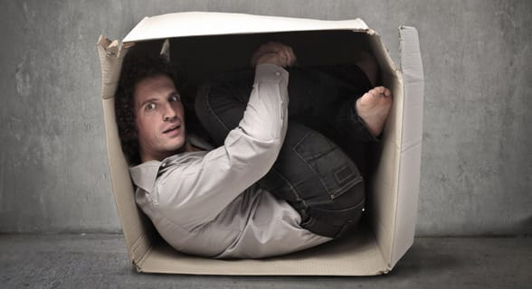 Photo of a man stuck in a box