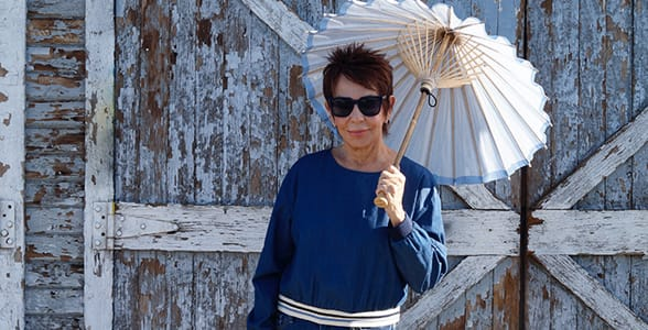 Photo of Dorrie Jacobson with a parasol