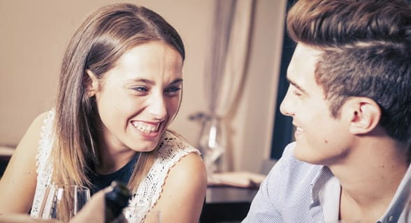 Photo of a man and woman laughing