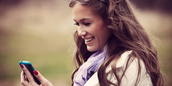 Photo of a girl texting and laughing