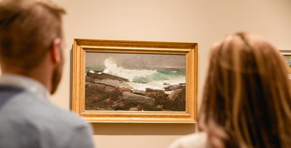 Photo of a couple looking at a painting at the PMA