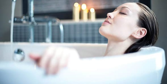 Photo of a woman taking a bath
